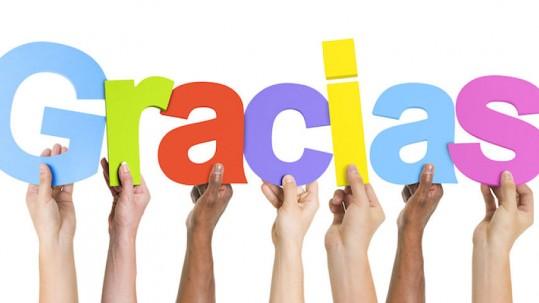 Multiethnic Group of Hands Holding Gracias